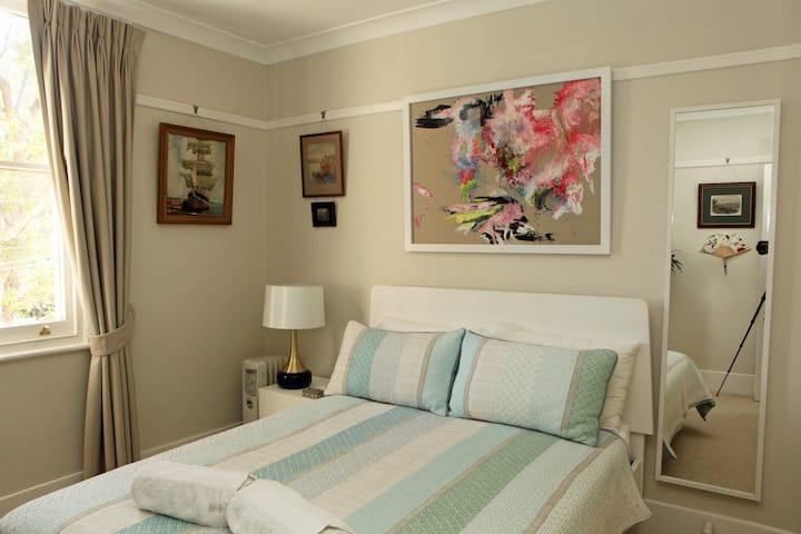 Elegantly furnished room with leafy outlook