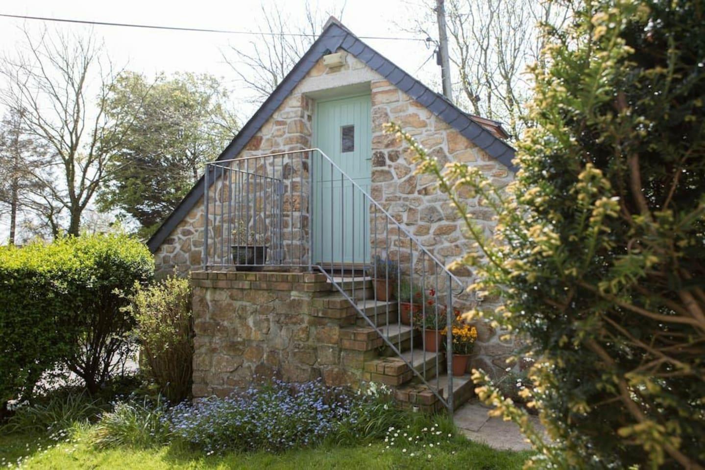 The Annex.  Steps lead  up to front door and living area/bedroom, bathroom below.