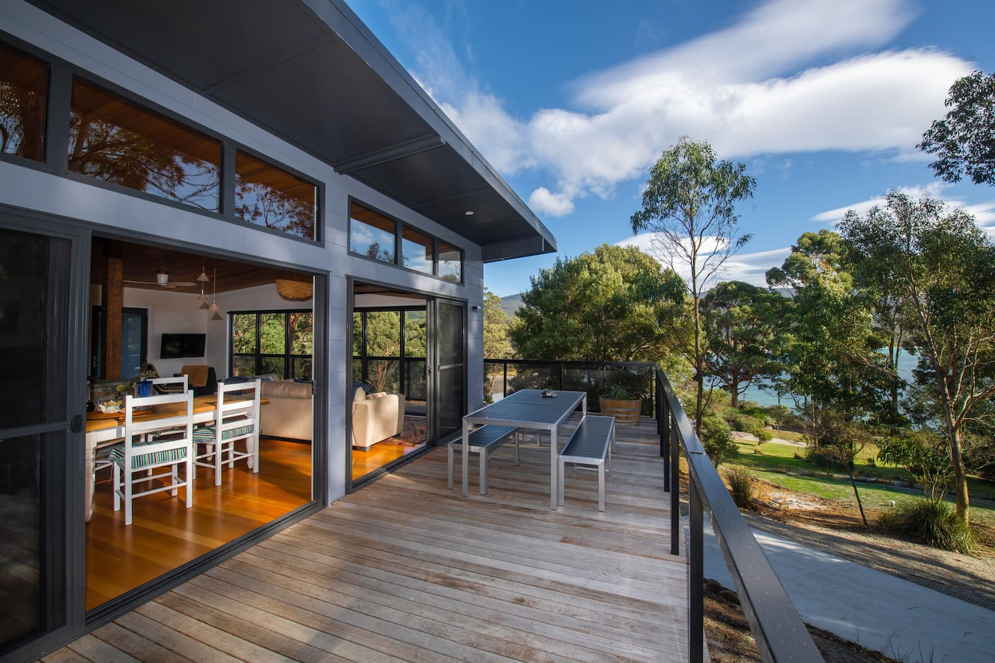New Adventure Bay Beach House. Perfectly positioned with beach and sea views from every room and an easy walk to the beach, a few steps away from the gate.