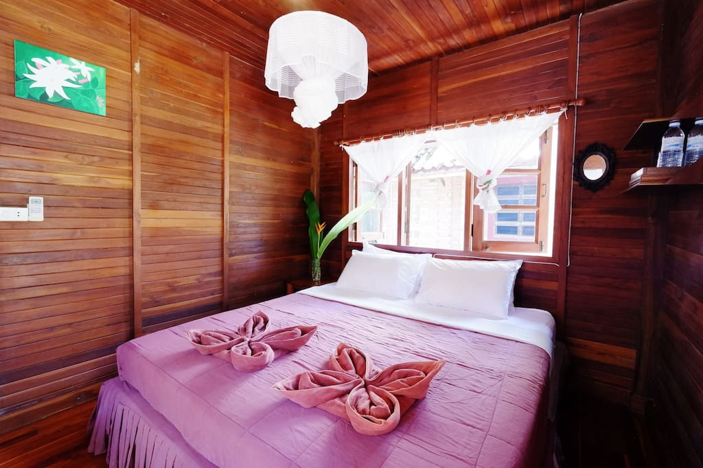 the solid teak wood bungalow. 1 bungalow ,1 kingside bed,1bathroom for 2 people