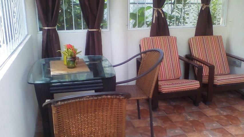 Patio which overlooks the garden. The patio has insect screens, security bars and Patio gate. Dine outdoors, or relax in  comfort in our enclosed patio.