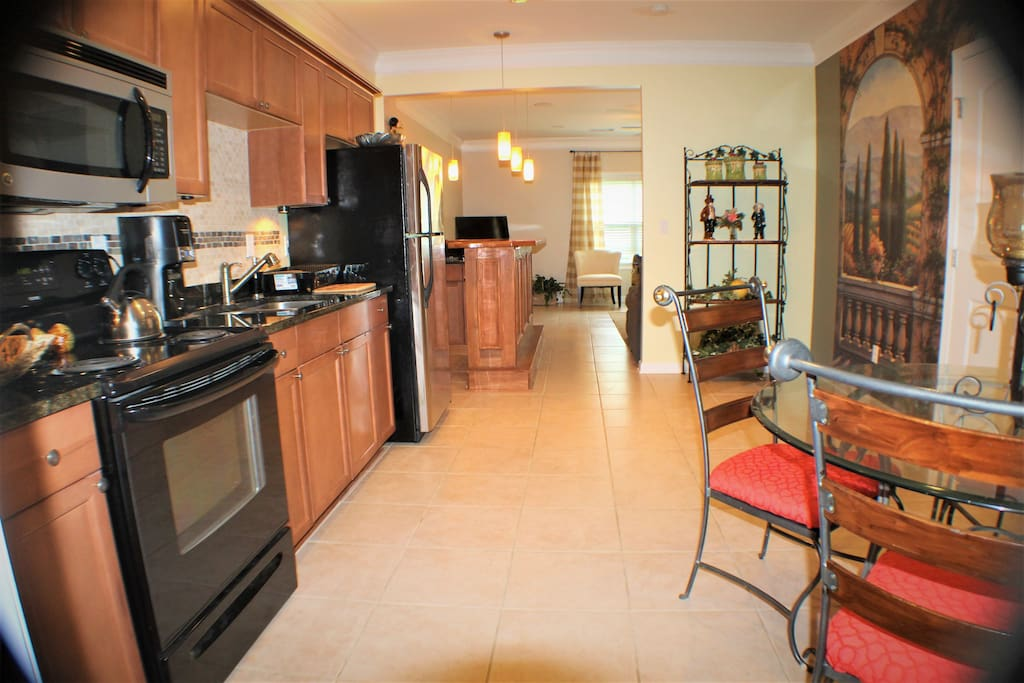 Full kitchen with dining area.  Everything you need if you are planning a long stay!