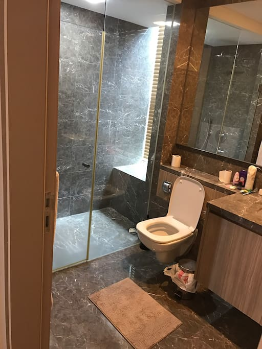 Bathroom of the master room. Huge shower area with shampoo etc provided. Very clean and there's a huge mirror inside too.