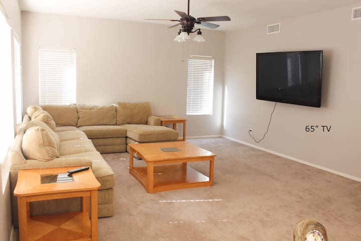 """Comfy Couch and 65"""" TV with Netflix & Amazon Prime"""