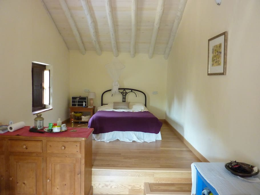 Split level bedroom with direct access to terrace.
