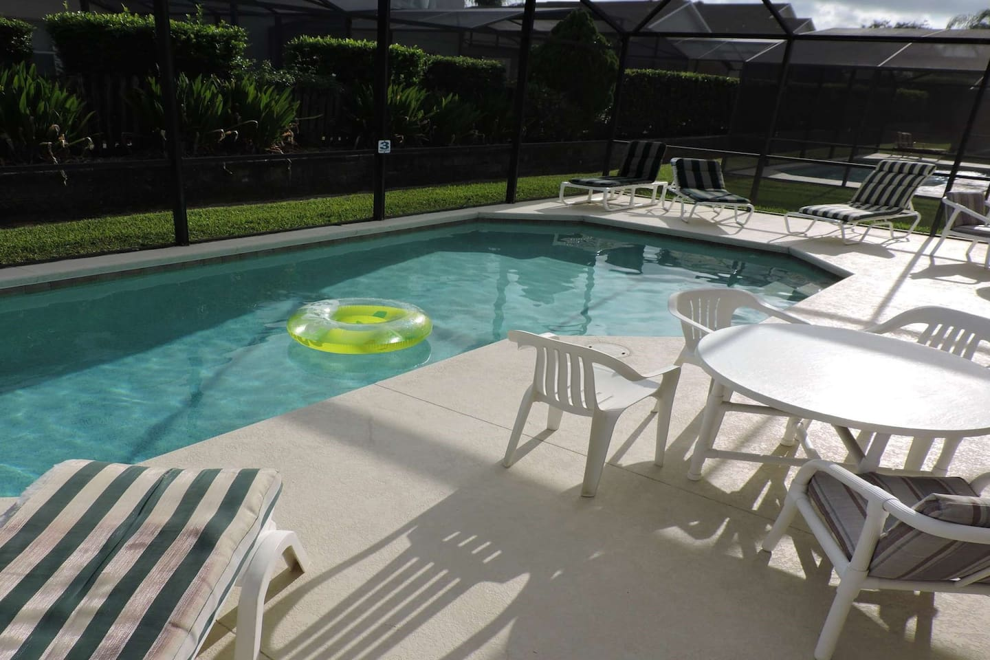 Large pool deck with al fresco dining