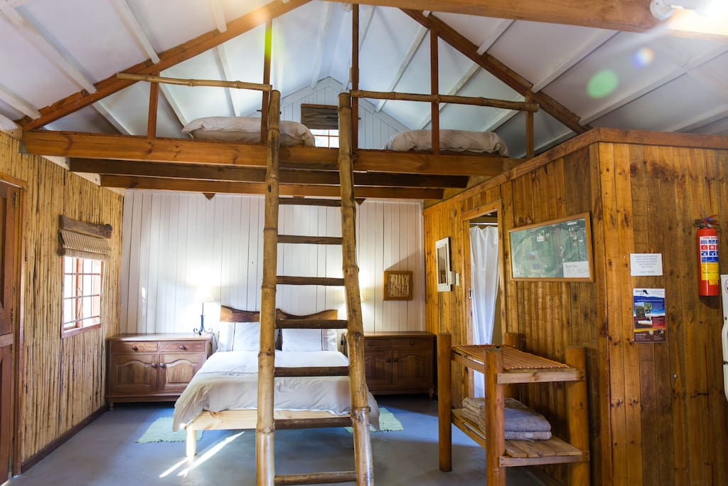 Dixon's View Interior with a double bed below and two singles in the rafters.