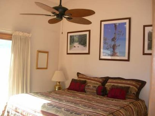 Master Bedroom Ceiling fan helps circulate high altitude fresh air! Full sliding glass door with screen door and walk out to the balcony.
