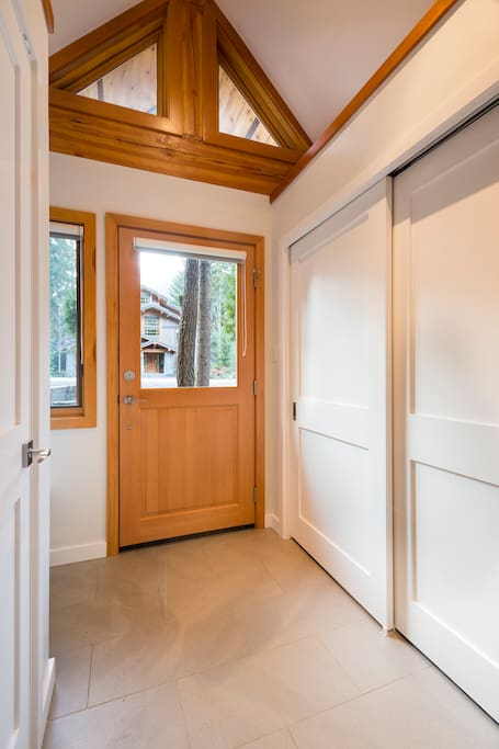 Entrance with lots of closet space and storage for skis, boots and boards