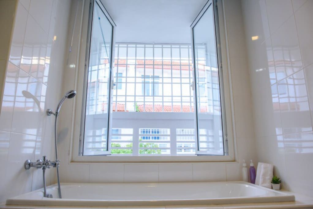Bath tub with standing shower in the bathroom Shampoo,shower gel and good quality towels are provide for everyone!
