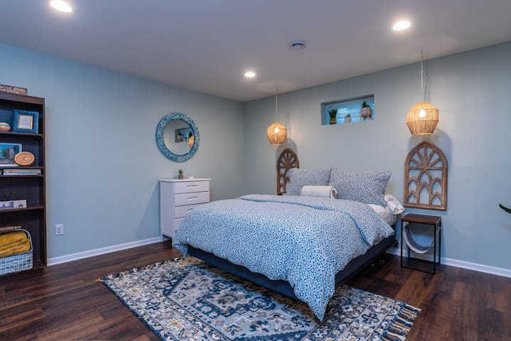This queen bed is in the main large room. Pendant lights are voice controlled with Alexa.