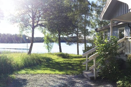 Lakefront cottage w Boat, Hot tub & Nature access