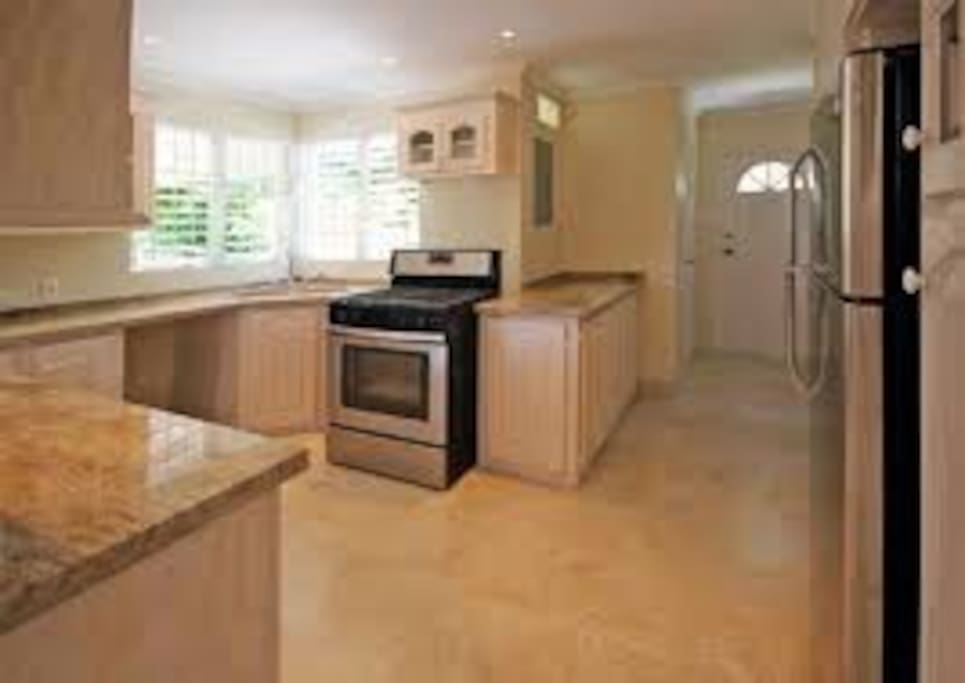 Upgraded kitchen with marble countertops and stainless steel appliances. (Gas range)