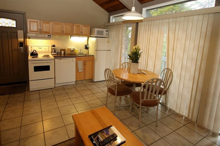 Cook up a storm in the equipped kitchen and enjoy your food at the lovely dining table.