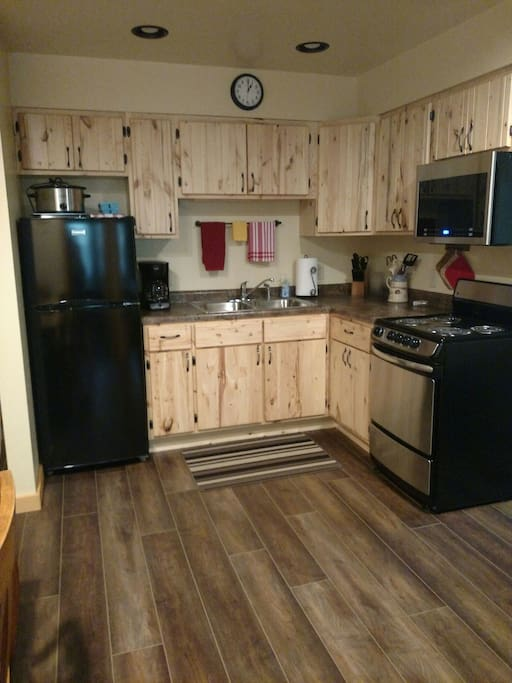 Guests will find serve, cook, and bakeware, plus basic seasonings in our Cozy Suite kitchen.