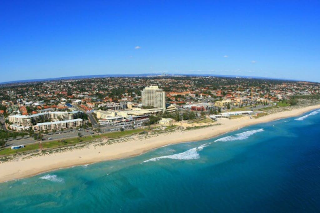 This is a great photo of famous Scarborough beach.      Your apartment is located opposite the tallest cream building in photo