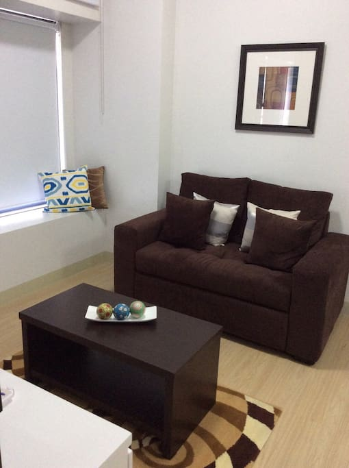 2 seater lounge & coffee table with Block out blinds.