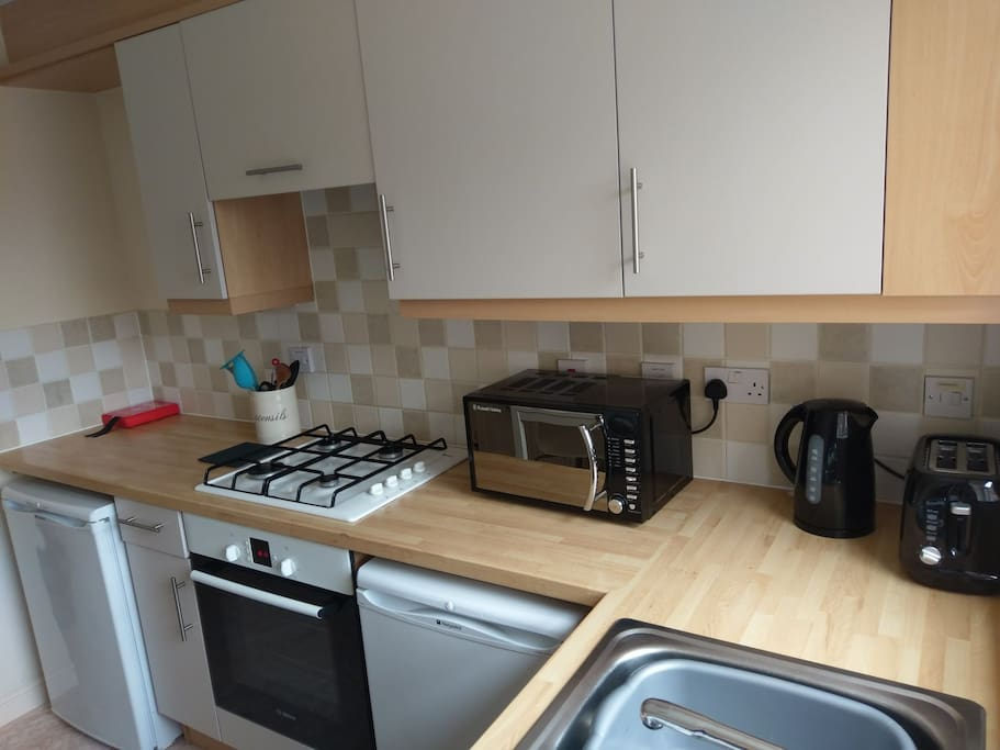 Kitchen includes microwave, kettle, toaster, fridge, freezer and washer dryer