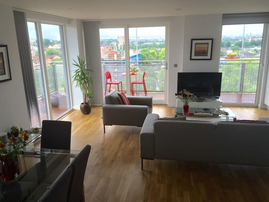 Shared living room  - floor to ceilling windows all around