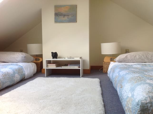 The loft - with a single bed on the left and a double bed on the right.