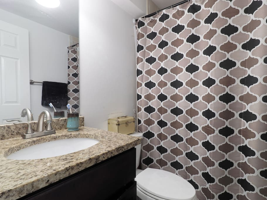 The bathroom is renovated and comes with all the amenities.