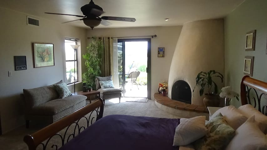 Sitting area in the room to relax.  Outside the room is a pond to relax and enjoy the our yard.