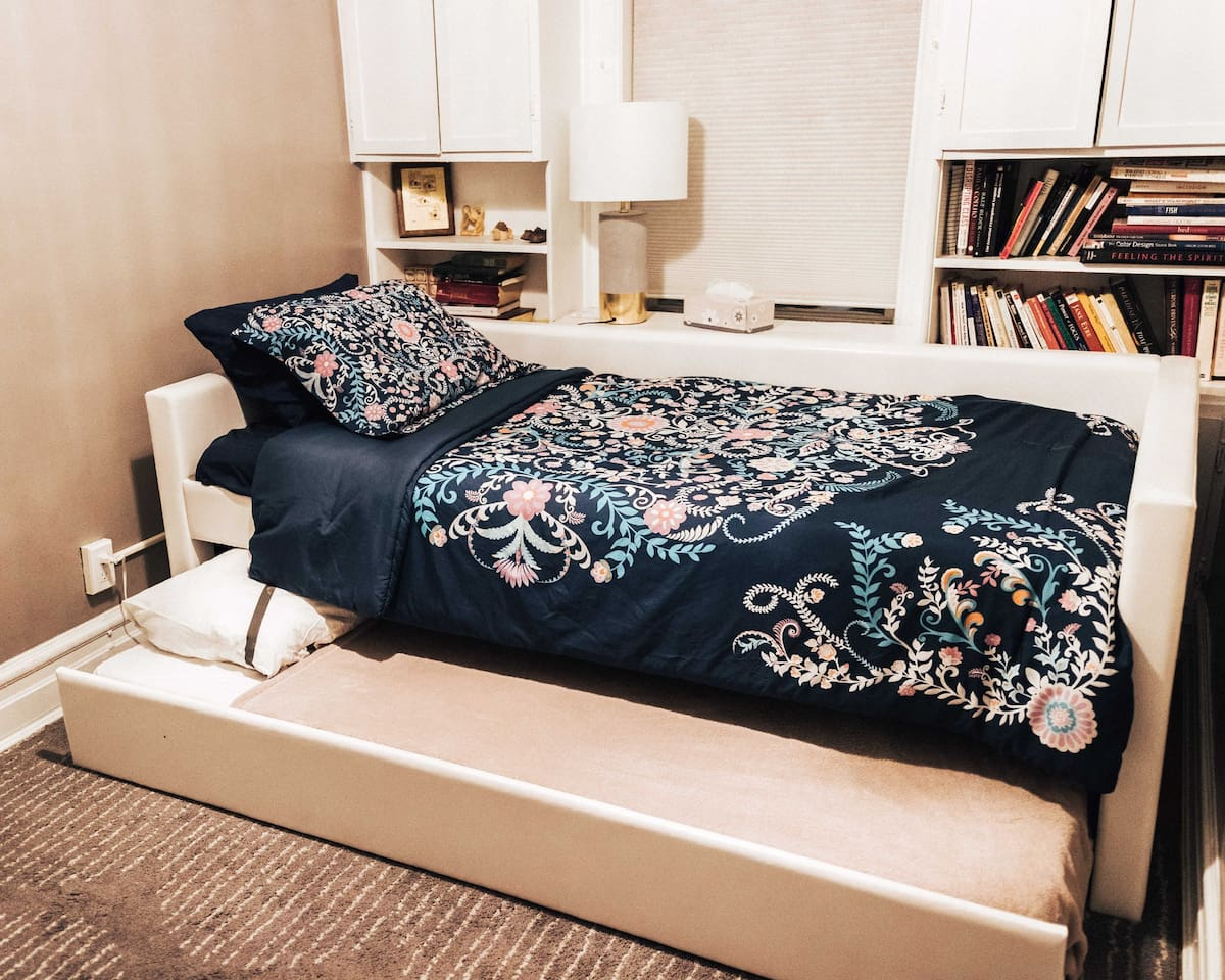 Comfy twin-sized bed. Choose to sleep up top or below. Or, get lost in a book. Perfect cozy space to relax.