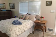 Double bed and nightstand table.