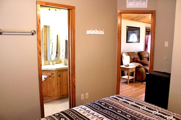 Bedroom looking towards bathroom and living room.