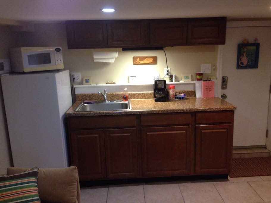 Kitchenette Area-Coffee maker, sink, microwave, fridge, plug in stove top, dishes and utensils