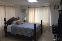"""New curtain drapery . w/ queen size bed, Wall cable 45"""" Flat screen TV."""