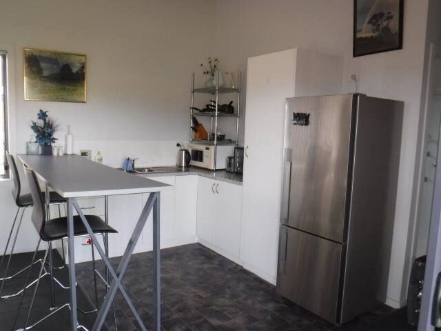 The kitchen is area is equipped with a wide range of cooking appliances.