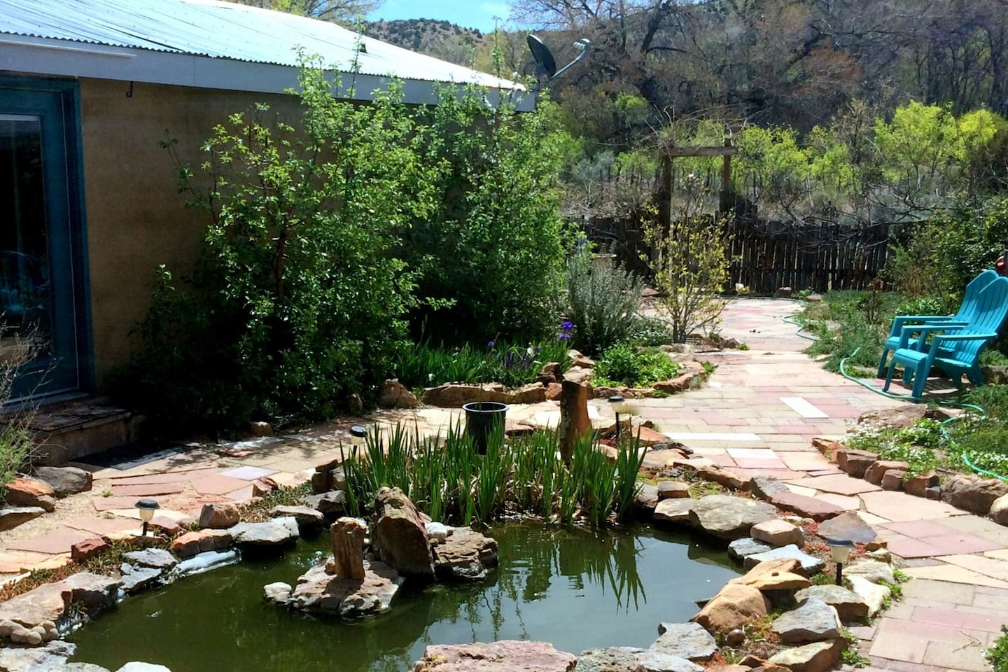 Fish pond is the highlight of the patio.  Guests are also free to use the hot tub on the patio.