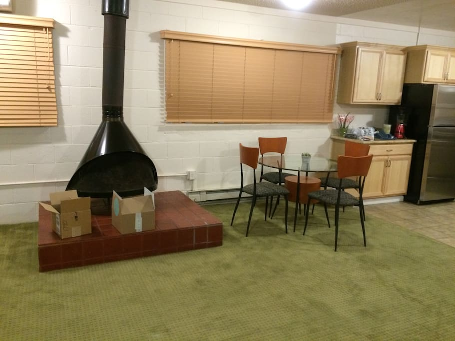 Fire place and dining table.