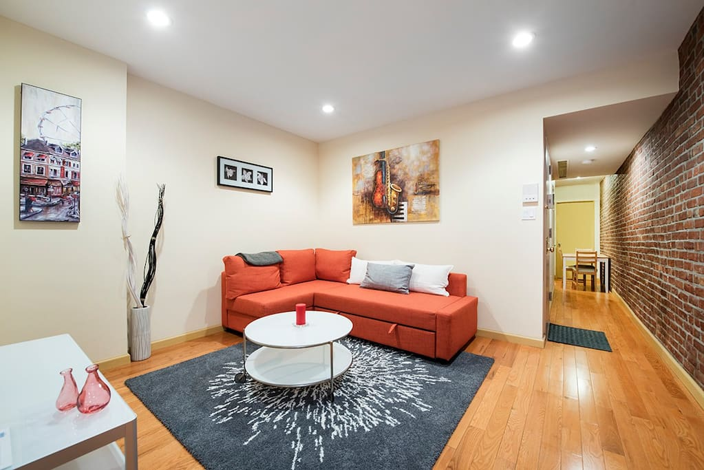 Captivating Living room set up. Large sectional couch. That turns into a double bed easily. Big flatscreen 50 Inch television with HIgh speed wifi.