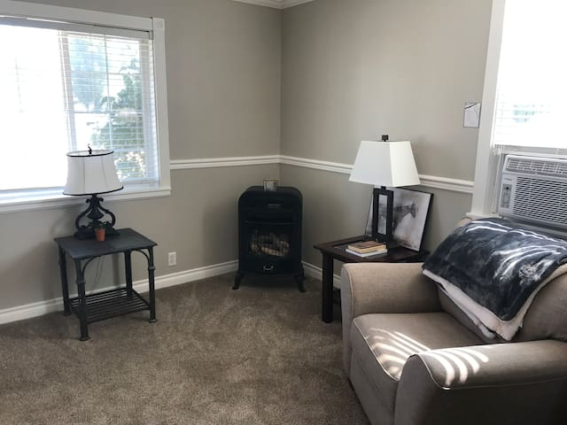 This sweet little sitting room boasts an open flame propane fire place, high end chair and a comfy throw, come in and warm up, or turn up the air if it's summer, grab a book and relax!