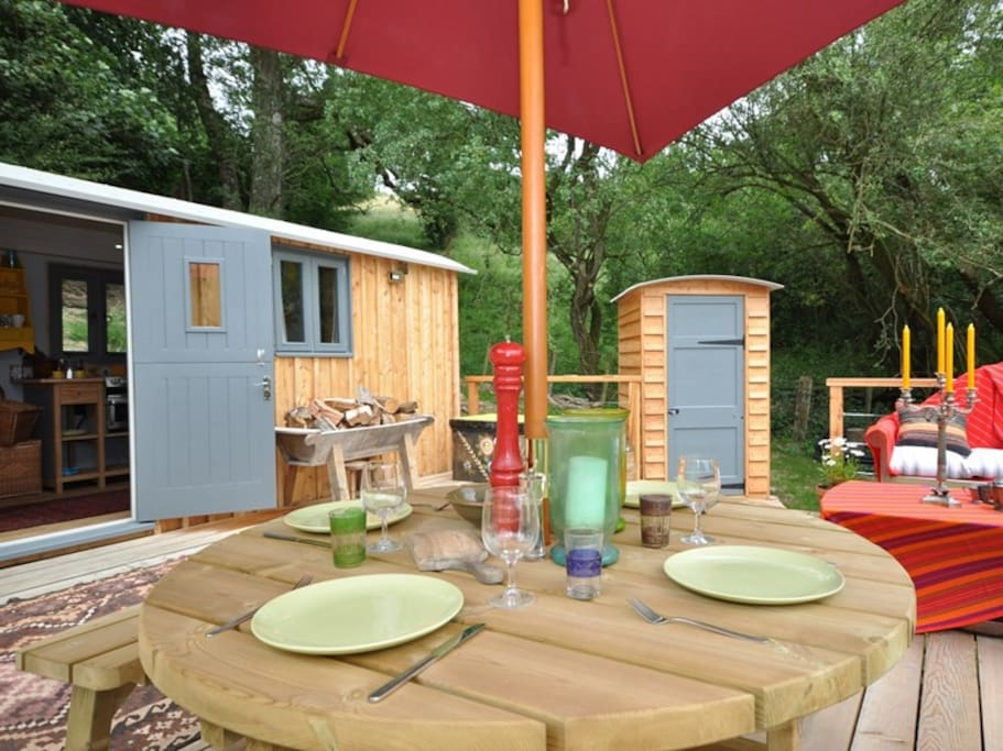 Table for Four on lovely wide decking (separate eco loo pictured to the right)