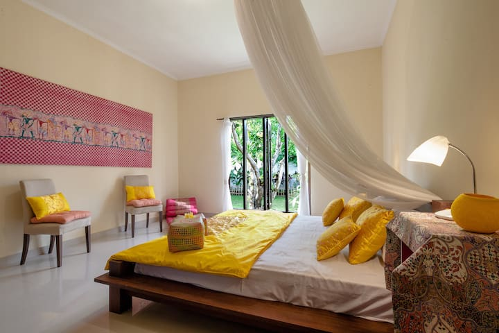 Beautiful Indonesian hand painted Batik decorating the bright house suite