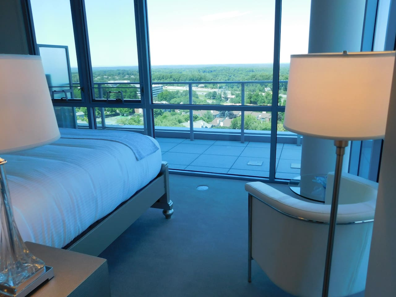 Wake to incredible views over Virginia from the floor-to-ceiling windows in the master bedroom