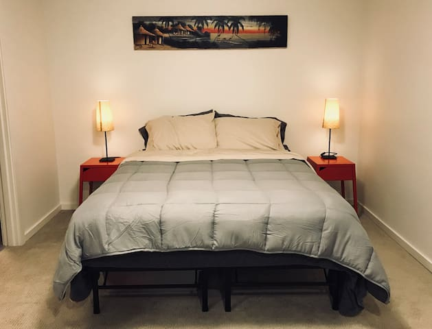 Queen bed with brand new mattress and bedding.
