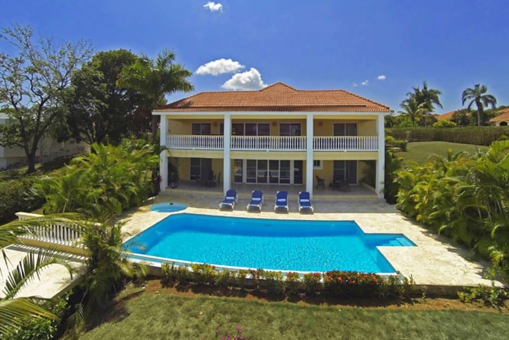 Oversize pool nestled in tropical garden