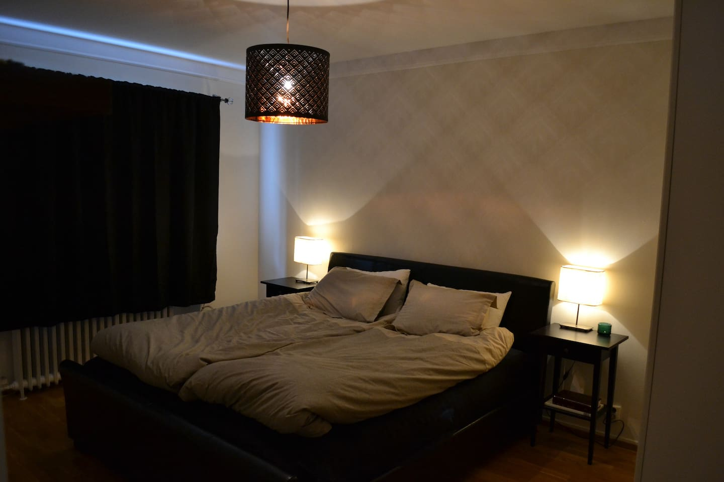 One bedroom is spacious with a queen size bed and a large closet.