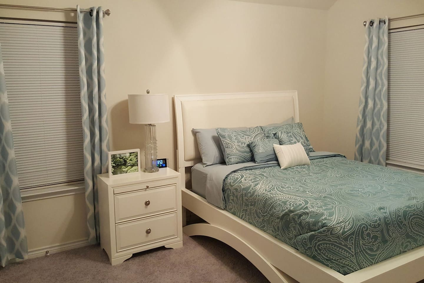 Spacious bedroom with plush bedding