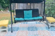 Swing on back patio if want to eat or relax in the backyard.
