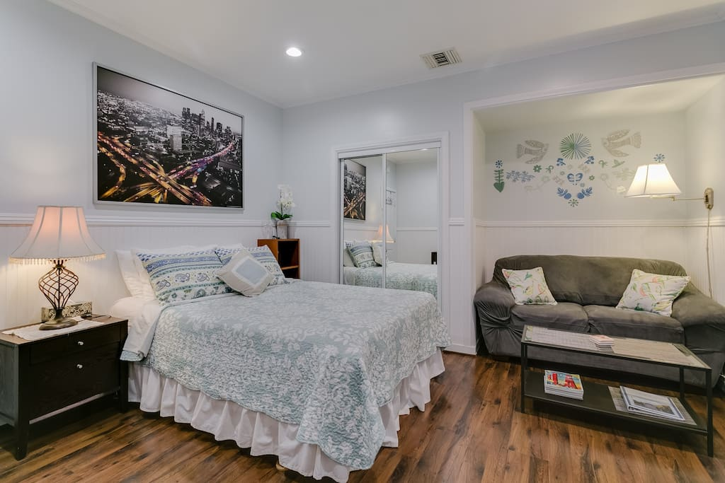 Spacious room with queen bed and sitting area.