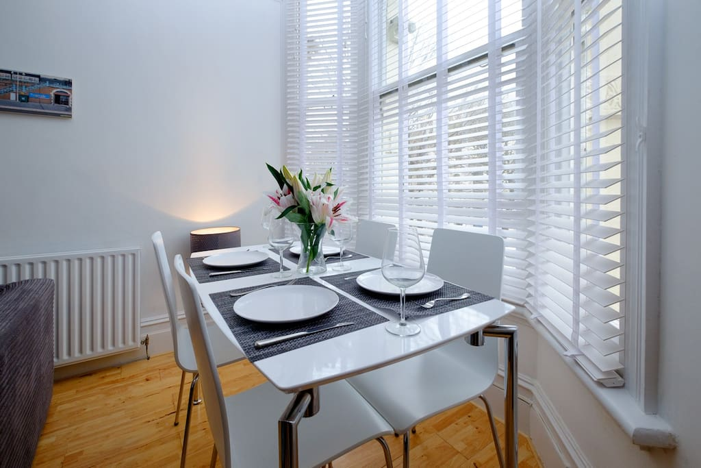 Eat dinner at the dining table in the light & bright lounge that seats 4