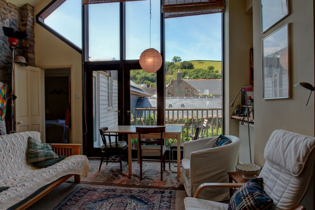 High-ceilinged space with views across the rooftops to Windmill Hill
