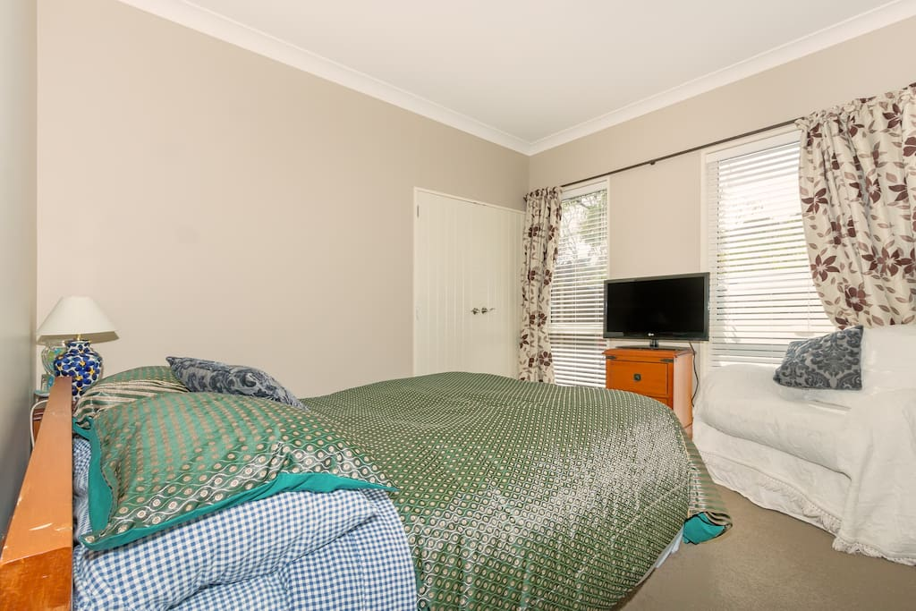Large robe and TV comfortable chair and double bed. Toilet nest door for convenience.