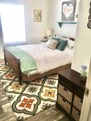 """"""" The Love Birds room""""  2nd bedroom with queen bed, mini dresser, large mirror and full closet with hangers and shelf. Bed has a 2"""" memory foam pad."""