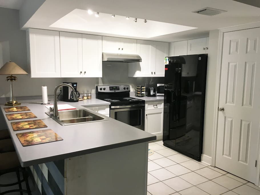 Kitchen with all new appliances and plenty of cooking and baking utensils for all of your homemade meals.